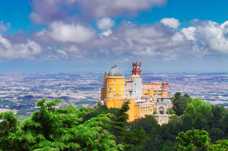 #Sintra, Portugal one of 11 most breathtaking views on Earth - via Family Traveller 16.10.2015 | #portugal #travel The Palace of Pena stands boldly atop a rocky peak, which is the second highest point in Portugal's Sinatra hills. Standing proudly at 528 m above sea level, it was built in such a way that it would always be seen from any point in the park, Parques de Sintra.