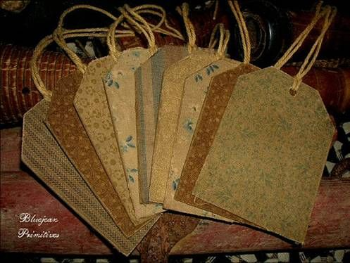 Primitive, fabric covered tags...  You could do  this with any fabric or scrapbook paper!