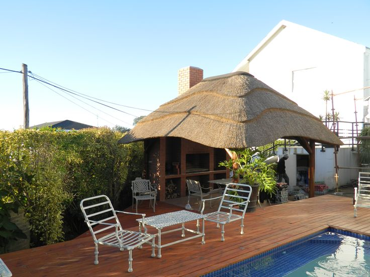 Another example of a small lapa in a small space by the pool, providing shelter and shade in an outdoor space