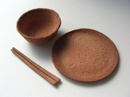 Japanese designer Nobuhiko Arika of Rice-Design created this tableware set for   Orito Cafe in Japan. This set is meant to replace traditional disposable tableware   by eating it when finished. The set is made from hardtach, a biscuit made from flour,   water and salt witch was traditionally used as dry emergency rations at sea. The set   will last for months if kep in dry conditions.