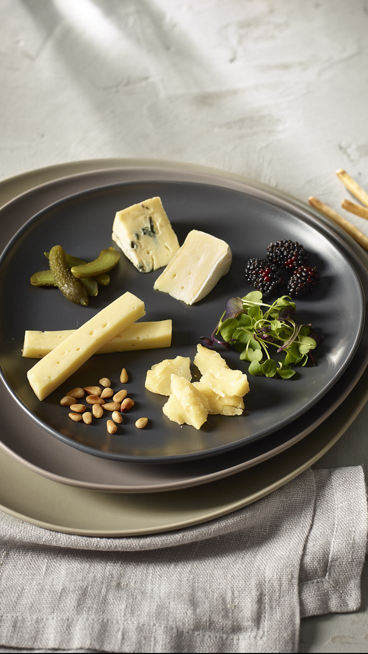 Less is more with this minimalist cheese plate. Perfect for any time of day or as an individual appetizer for your next dinner party, this striking cheese plate takes just minutes to assemble.