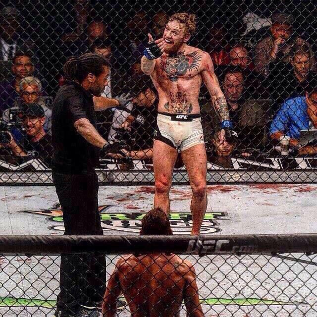 Conor McGregor messing with head of Chad Mendes at #UFC189 : if you love #MMA, you'll love the #UFC & #MixedMartialArts inspired fashion at CageCult: http://cagecult.com/mma