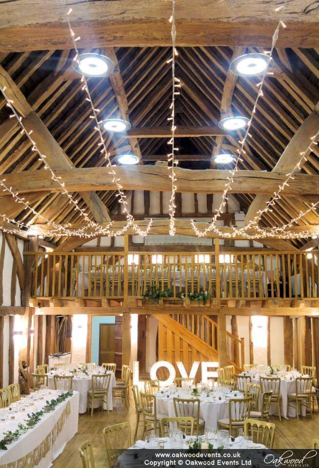 Pure pretty, a single swag fairy light canopy in the barn at the Tudor Barn Burnham. Wedding lights are a brilliant decor element for sparkle