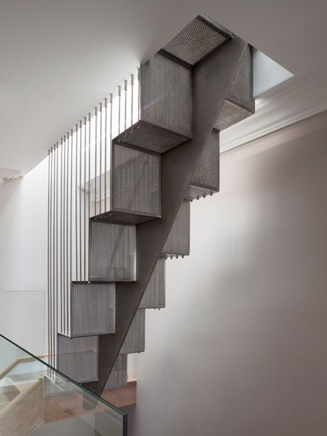 Perforated steel staircase added to refurbished London home.