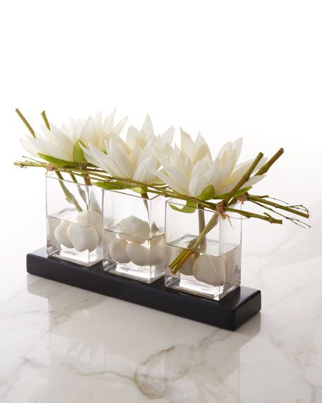 #ONLYATNM Only Here. Only Ours. Exclusively for You. Handcrafted faux-floral arrangement. Synthetic-silk flowers and elephant reed. Three glass vases. Acrylic water. 21W x 8D x 11T. Imported.