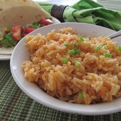 Spicy Spanish-Style Rice  - Allrecipes.com  Tone down the spices  a bit if feeding a crowd.
