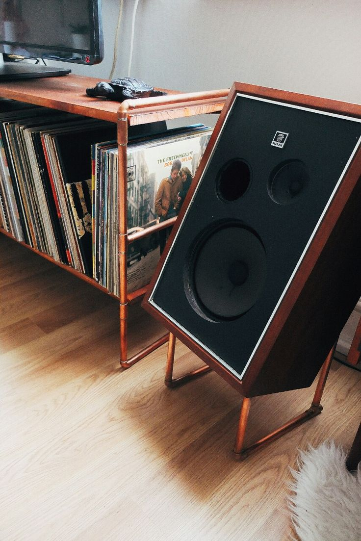 Tired of my budget IKEA furniture I decided to design and build my own. Soldered copper framework with teak stained pine shelves, with matching laid back copper speaker stands.