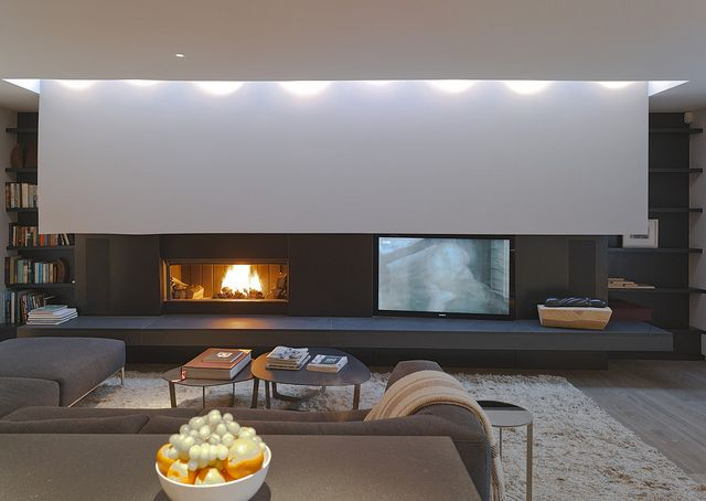 I love this fireplace and tv setup for a media room, with the pull down projection screen