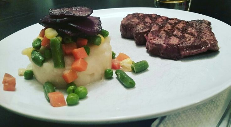 Milet mignon with vegetable medley over celery  root puree and beet chips on top.