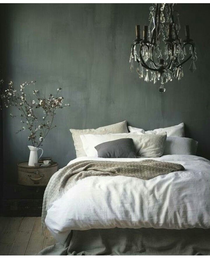 A Colorful Bedroom with a steel bed, a polished floor,