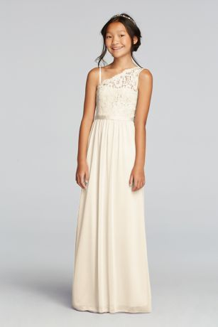 Your junior maids will adore this pretty lace one shoulder dress!  Floor length mesh dress features a beautiful one shoulder lace bodice with an optional spaghetti strap for extra comfort.  Attached grosgrain ribbon detail at waist.  Complements perfectly with Bridesmaid Style F17063.  Fully lined. Imported. Back zipper. Dry clean only. To protect your dress, our Non Woven Garment Bag is a must have!