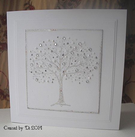 The gilding flakes won this round - there wasn't really enough coverage on this gorgeous Penny Black tree.  I added three Stickles and two Liquid Pearls as well as some gems to it, so you can hardly tell!  I added a couple of white layers as I wanted to keep the design very clean but the card needed a little something extra and I think the white layers worked well.: