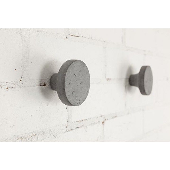 This wall hook is made from a mix of polystone and concrete powder, making it super strong without losing the concrete look and feel.   Comes with the screw and a wall plug, ready to be installed.  Measurement: Diameter 8 x Height 5 cm