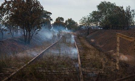 Tracks on an abandoned railway line smoulder near Freeling.