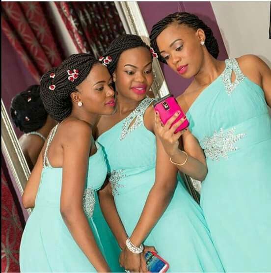 Gorgeous bridesmaids in turquoise and silver one shoulder dresses