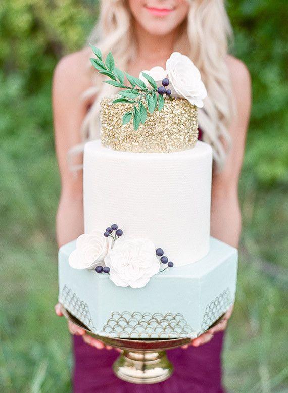 Gold sparkly top tier wedding cake