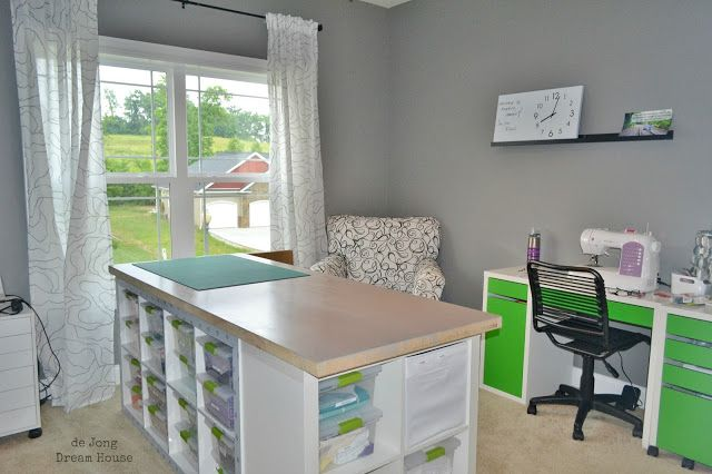 DIY Craft Table - great details about the ikea bookshelves used and a hollow core door. Also, good details about the types of bins to use in the shelves.