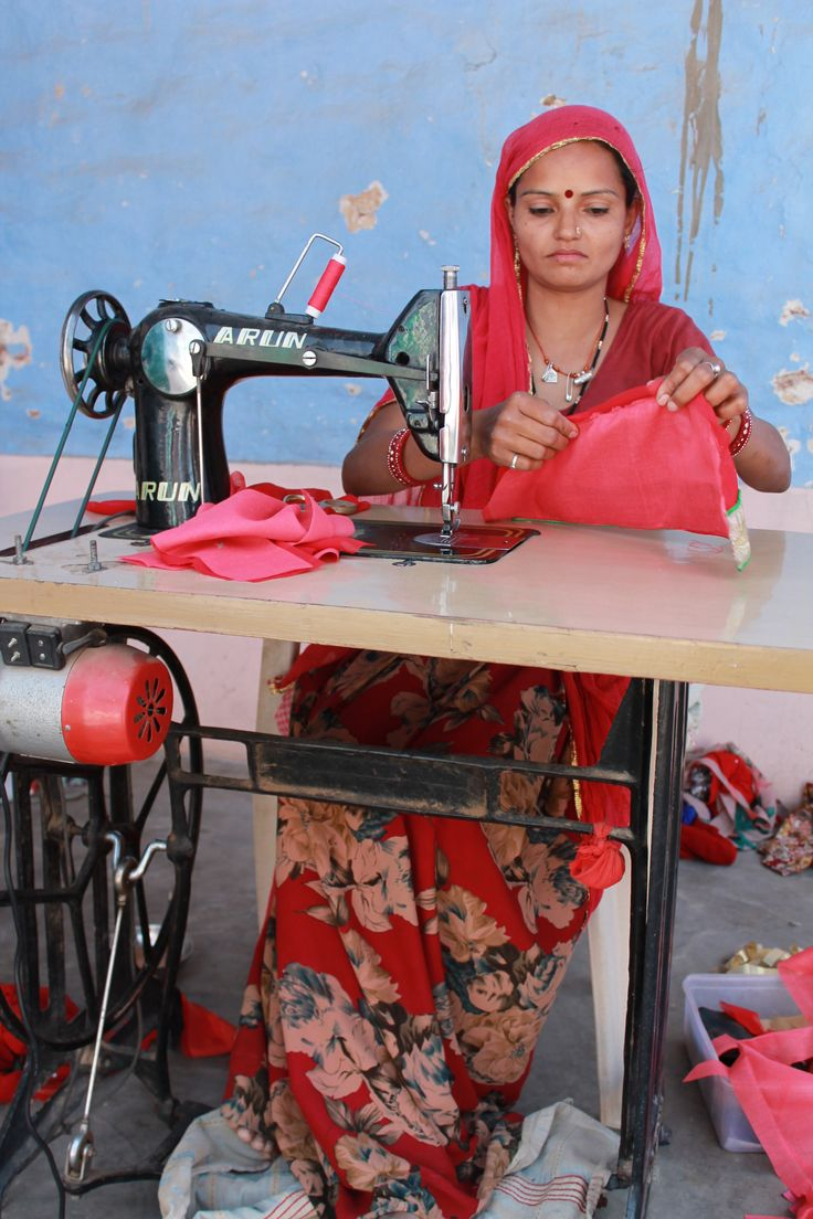Stitching a blouse using a traditional silai machine in rural Rajasthan.