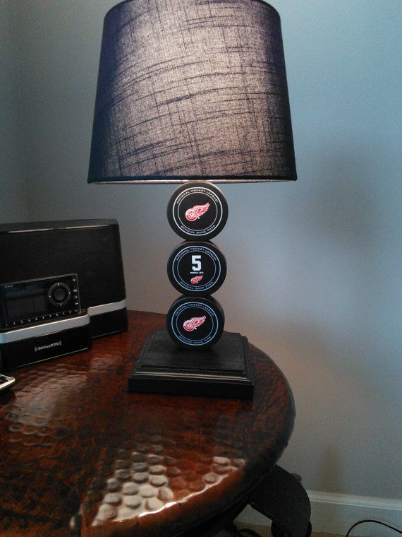 Nicklas Lidstrom Detroit Red Wings Lamp with Official Game Pucks on Etsy, $100.00