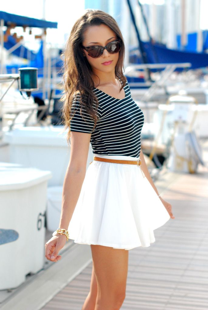 So nautical. Navy and white stripe shirt over a white pleated skirt and a skinny brown belt to cinch the waist.