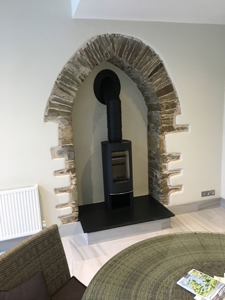 Elegant Scan mini installed into a beautiful stone archway by Kernow Fires in Cornwall