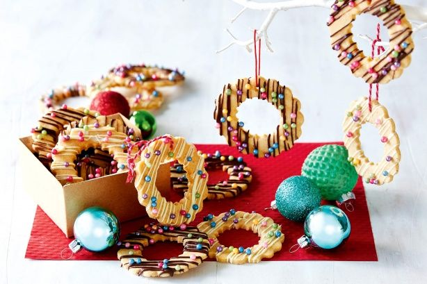 Turn your Christmas decorations into delicious edible gifts with these buttery wreath biscuits!