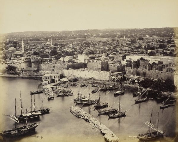 The Harbour of Rhodes  15 May 1862.Elevated general view of boats moored in Rhodes harbour, and town beyond. The photograph is signed and captioned in the negative, 'F Bedford Rhodes'. Francis Bedford (1815-94) Acquired by the Prince of Wales (later King Edward VII), 1862.