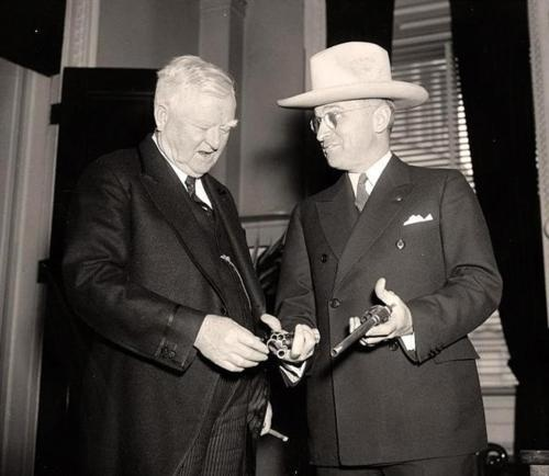 Harry Truman and John Nance Garner with 6 shooters. Vintage