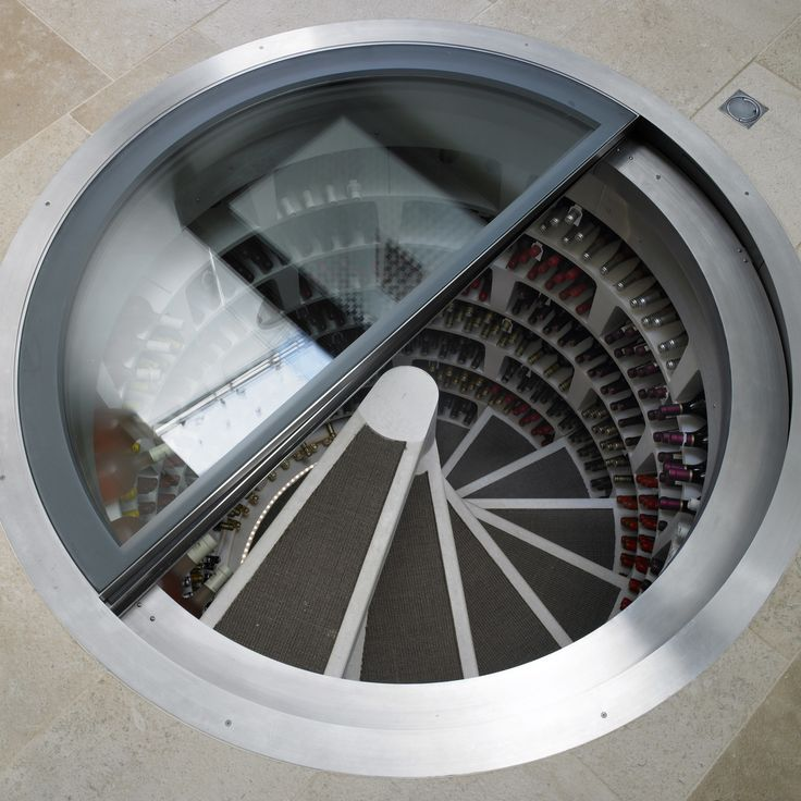 White Spiral Cellar with retractable round glass trapdoor!