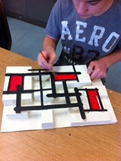 """Piet Mondrian In Low Relief - """"The students were excited to see if they could """"fool"""" the viewer into thinking that their art was a flat painting rather than a relief sculpture. We set out to see if we could """"keep it flat"""" by creating a composition of horizontal and vertical lines, geometric shapes and colors without value shifts."""""""