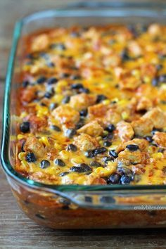 This Layered Chicken Enchilada Bake is a Mexican comfort food casserole your whole family will love. Just 339 calories or 8 Weight Watchers SmartPoints! http://www.emilybites.com