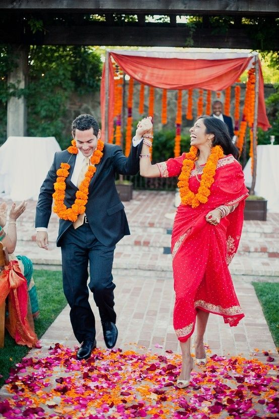 These Indian newlyweds celebrate right after they tie the know. These floral details really make the scene.