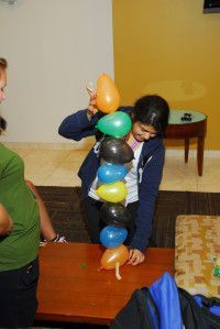 Team Building Activity: Balloon Tower - for fitness component, each team is assigned a color of balloon and they are scattered throughout the room