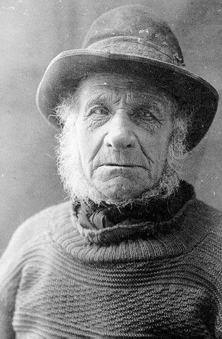 Portrait of Cromer fisherman Gilbert 'Leather' Rook wearing a gansey and chummy hat.