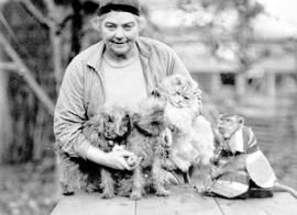 Emily Carr and some of her companion animals, including Woo the monkey, Victoria, 1940