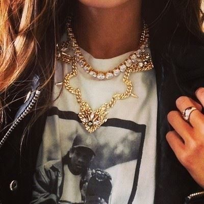 { gold crystal necklace over a graphic t-shirt }