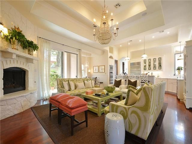 Chic Living Room With White And Green Sofas Facing Each Other Accented Fringed Pillows Paired Lacquer Coffee Table