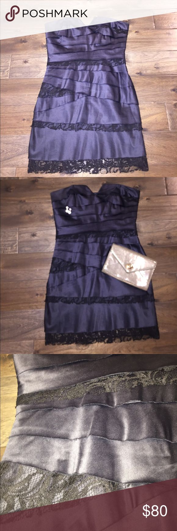 BCBG Strapless Cocktail Dress BCBGeneration dress in tiered layers of slate-gray satin and black lace. Strapless and formfitting with a sweetheart neckline and a hidden side zip. Worn once-great condition! Mid-thigh length. So elegant with some sparkly jewelry and a metallic clutch! BCBGeneration Dresses Mini
