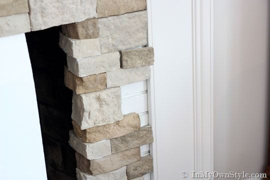 Reface fireplace brick with Airstone - this sounds promising