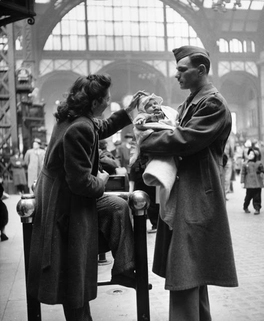 A soldier says goodbye to his wife and infant child in Pennsylvania Station before shipping put for service in World War II, New York, 1943