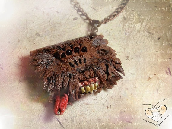 Harry Potter Monsters Book pendant. now that! is awsome! i would have to wear it on a rope cord though. i could try to make that!