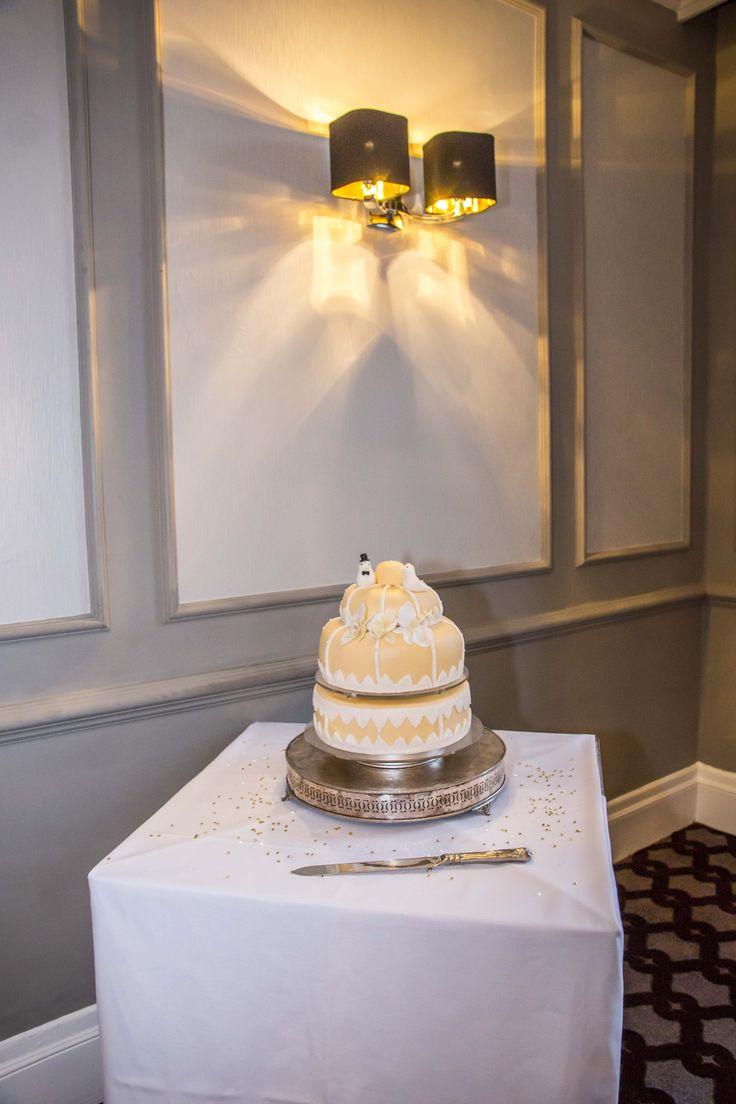 Bird cage, peach coloured 2 tier Wedding cake.