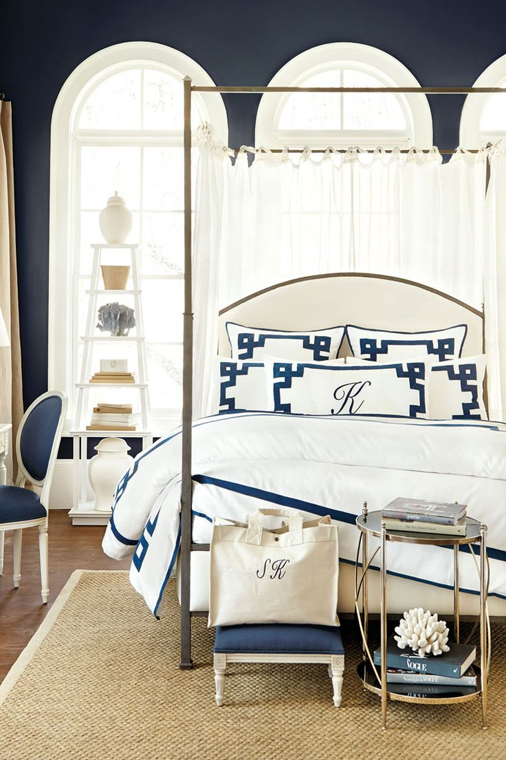 Our Louisa Metal bed lined with sheer linen tie top drapes with Suzanne Kasler's greek key bedding.