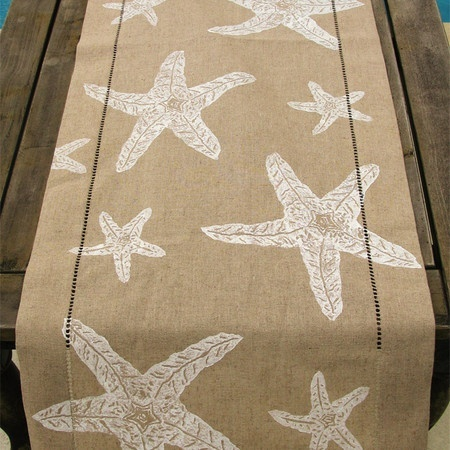 Seas star table runner on a tan linen.