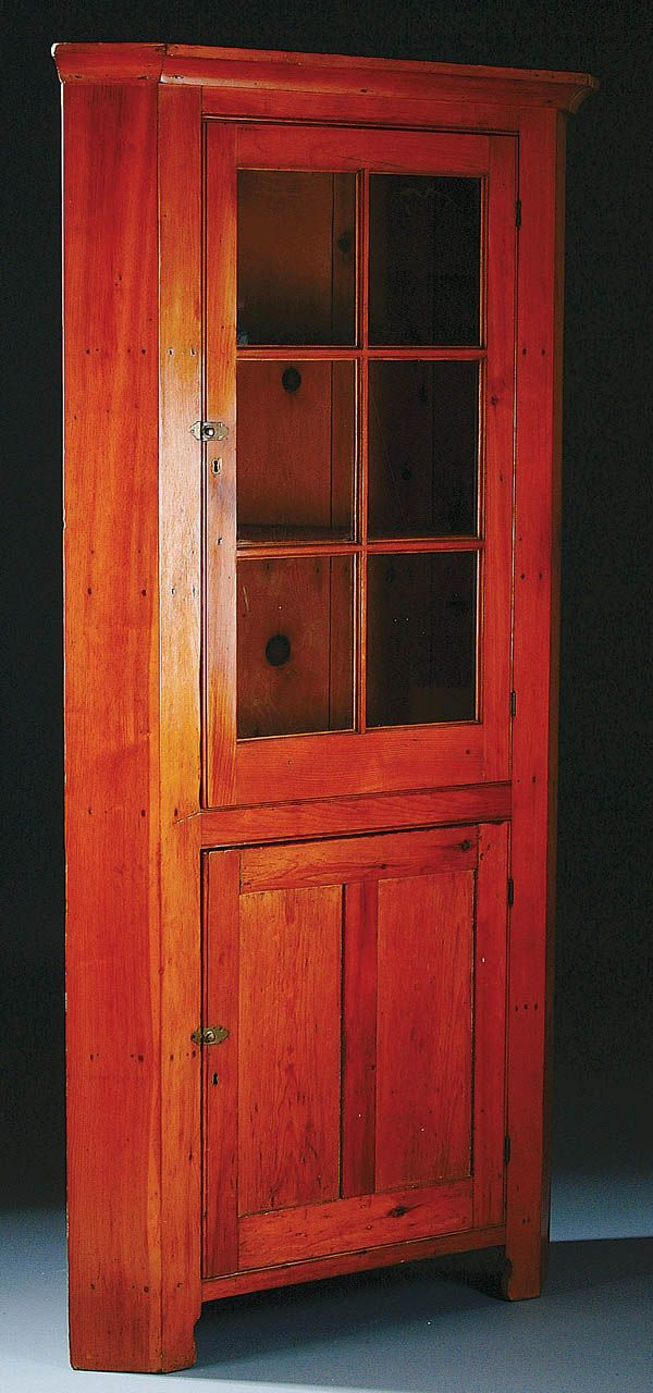 AN EARLY AMERICAN PINE CORNER CUPBOARD, circa 1830