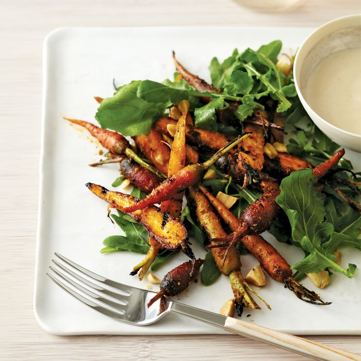 Grilling concentrates the sweet flavor of fresh baby carrots in this salad tossed with a nutty dressing of browned butter, marcona almonds and sherry vinegar.