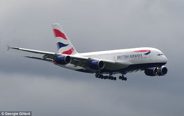 A monster in the gloom: BA's first new Airbus A380 comes into land at Heathrow this morning marking the start of a delivery of 12 of the £270m planes 4.7.13