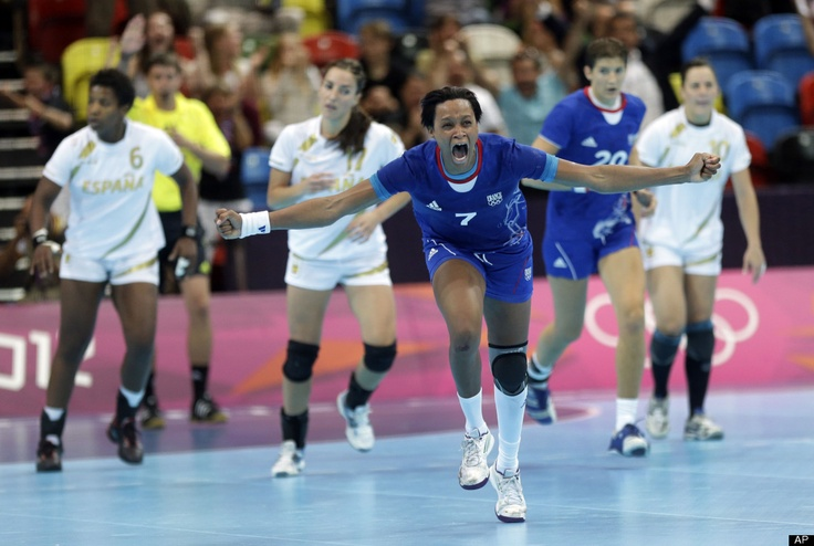 Allison Pineau of France celebrates after scoring during their women's handball preliminary match against Spain at the 2012 Summer Olympics, Monday, July 30, 2012, in London.