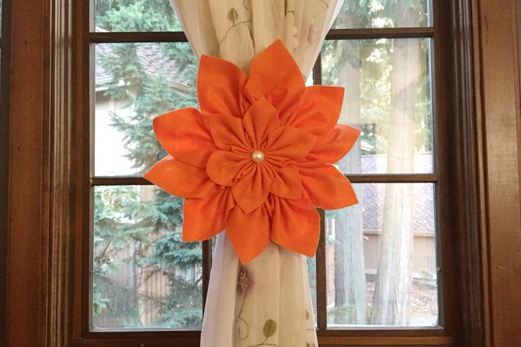 A personal favorite from my Etsy shop https://www.etsy.com/listing/468010730/orange-kanzashi-flower-curtain-tiebacks