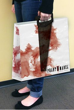 This packaging for a gothic-themed fashion store was conceived by Kimber Thompson (Digital Arts and Design, 2012 graduate). The handles on the shopping bags would look like the customer is holding a saw or a pair of brass knuckles.